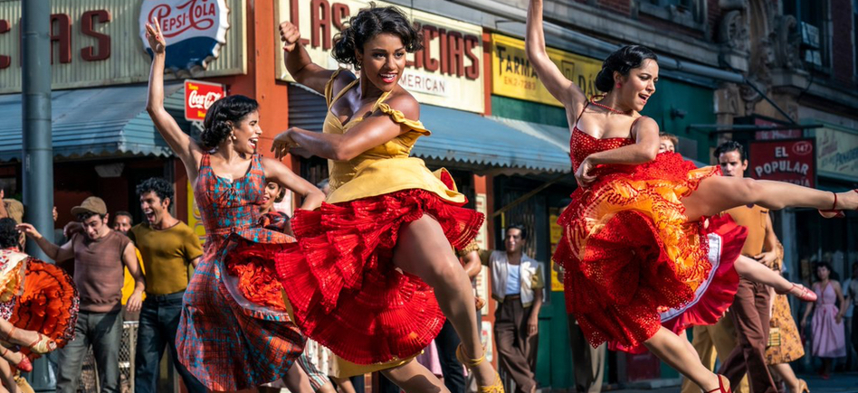 Anita (Ariana DeBose) dances in the streets, backed by other women dancers.