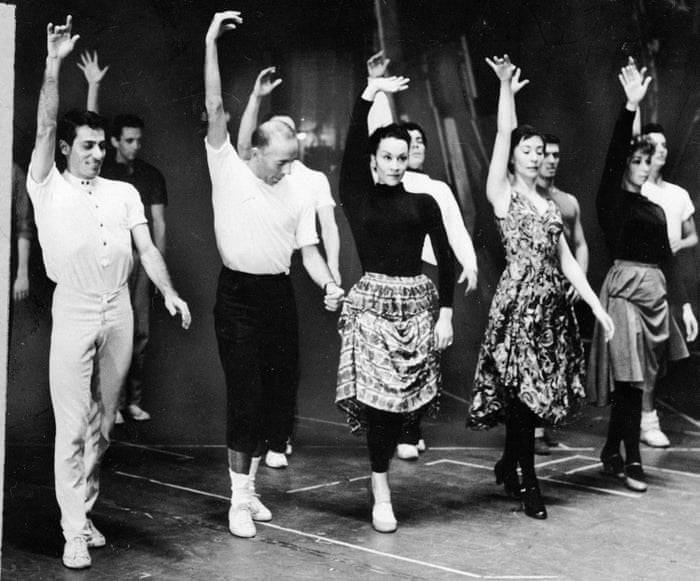 Jerome Robbins gives direction to Chita Rivera during dance rehearsal